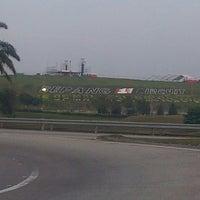 Photo taken at Sepang International Circuit (SIC) by Aidil A. on 3/20/2013