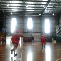 Photo taken at Carrara Indoor Sports Stadium by Ade N. on 12/18/2012
