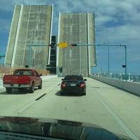 Photo taken at Johns Pass Bridge by Jillian S. on 9/15/2012