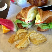 Photo taken at Le Croissant Cafe by Greg V. on 6/13/2013
