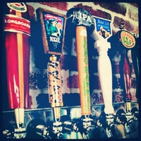Photo taken at World of Beer by Kenny H. on 8/11/2013