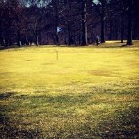 Photo taken at Big Met Golf Course by Jon K. on 4/1/2014