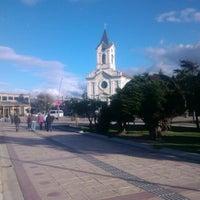 Photo taken at Plaza de Armas de Puerto Natales by Oscar C. on 2/16/2013