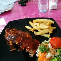 Photo taken at Rumah Cupcakes & BBQ by Anang G. on 6/29/2014