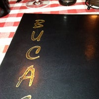 Photo taken at Buca's Tuscan Roadhouse by Carlos N. on 11/18/2012