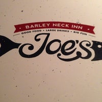 Photo taken at Joe's Beach Road Bar & Grille at The Barley Neck Inn by Carlos N. on 7/16/2014