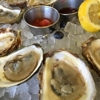 Photo taken at Fishbones Oyster Bar & Grill by Craig W. on 8/24/2016