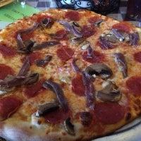 Photo taken at Ramunto's Brick Oven Pizza by Craig W. on 10/26/2013
