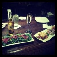 Photo taken at Fish Urban Dining by Thomas S. on 7/13/2013