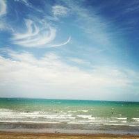 Photo taken at Long Bay Beach by Tùng P. on 1/22/2013