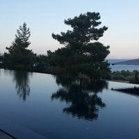Photo taken at Amanrüya Beach Club by Dilek A. on 8/24/2015