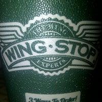 Photo taken at Wingstop by Jonny M. on 10/12/2012