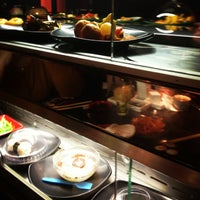 Photo taken at Wasabi Running Sushi & Wok Restaurant by Liliána B. on 12/23/2012