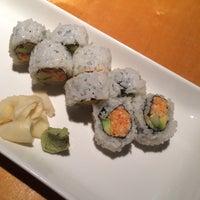 Photo taken at Sushi Cafe by Caroline D. on 7/20/2015