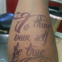 Photo taken at Atomic Tattoo by Winton W. on 11/9/2012