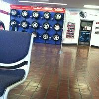 Photo taken at Firestone Complete Auto Care by Jennifer D. on 12/10/2012