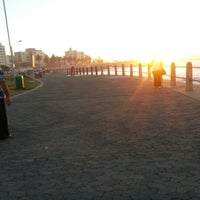 Photo taken at Sea Point Beach Promenade by Yajna G. on 12/18/2012