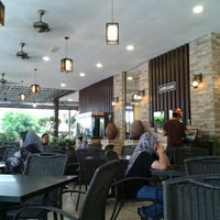 Photo taken at De Pauh Garden Restaurant & Cafe by Dyana L. on 9/20/2012