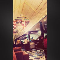 Photo taken at Giggle Box Cafe & Resto by Ramadhan D. on 2/12/2014