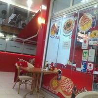Photo taken at Pizza Tomato by Esra C. on 3/21/2013