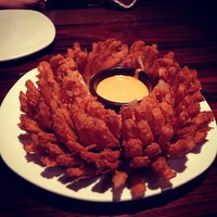 Photo taken at Outback Steakhouse by Ale M. on 7/21/2013