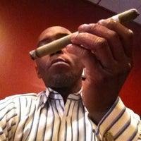 Photo taken at Fume Cigar Shop & Lounge by Aristippos on 11/9/2013