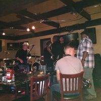 Photo taken at Q Restaurant & Sports Bar by Sally C. on 7/4/2014