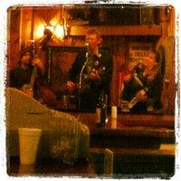 Photo taken at Dürty Nelly's Pub  & Wayside Deli by Jeff B. on 3/27/2013