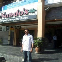Photo taken at Nando's by Abhishek M. on 11/18/2012