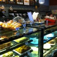 Photo taken at Joma Bakery Café by Sara on 12/8/2012