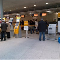 Photo taken at Lufthansa Check-in by Julian W. on 11/24/2012