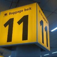 Photo taken at Baggage Belts by Julian W. on 3/9/2013