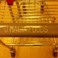 Photo taken at O'Malia's Food Market by Johnny S. on 4/14/2013