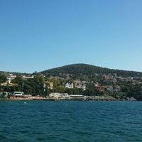 Photo taken at Büyük Ada Sahili Gün Batımı 🌅 by Ebru D. on 7/23/2016