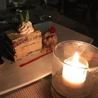 Photo taken at Jimbaran Beach Cafe by Michael B. on 1/10/2017