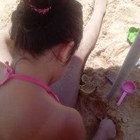 Photo taken at Praia da Direita by Fernanda N. on 3/5/2014