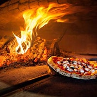 Photo taken at Burrata Wood Fired Pizza by Burrata Wood Fired Pizza on 7/24/2015