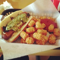 Photo taken at The Slaw Dogs at the Village by Dexter J. on 1/1/2013