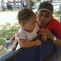 Photo taken at Dampo Awang Beach by Tris B. on 10/7/2012