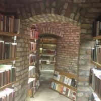 Photo taken at Minoa Bookstore & Café by Fulya G. on 8/8/2015