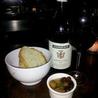 Photo taken at Aroma Kitchen & Wine Bar by denise p. on 1/15/2012