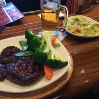Photo taken at Outback Steakhouse by Takuo I. on 4/1/2014