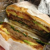 Photo taken at Sunny & Annie Gourmet Deli by Melissa C. on 3/3/2013