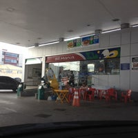 Photo taken at Posto BR by May M. on 9/21/2013