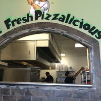 Photo taken at Zeko's Pizzeria & Grill by Travis C. on 6/4/2014