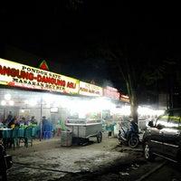 Photo taken at Pondok Sate Danguang-Danguang Asli by Merry F. on 3/5/2015