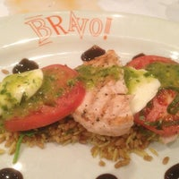 Photo taken at Bravo! Cucina Italiana by Kris on 2/23/2013