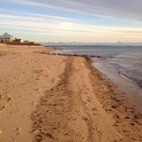 Photo taken at Popponesset Beach by Jennifer S. on 1/1/2014