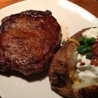 Photo taken at Outback Steakhouse by Johnny V. on 3/12/2013