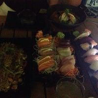 Photo taken at Mizu Asian Bistro + Bar by Lucy Y. on 5/4/2014